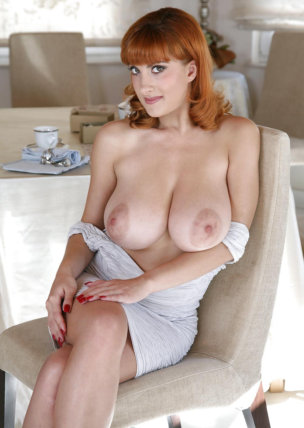 Sexy redhead woman with big tits and in erotic white stockings is getting fucked in many positions